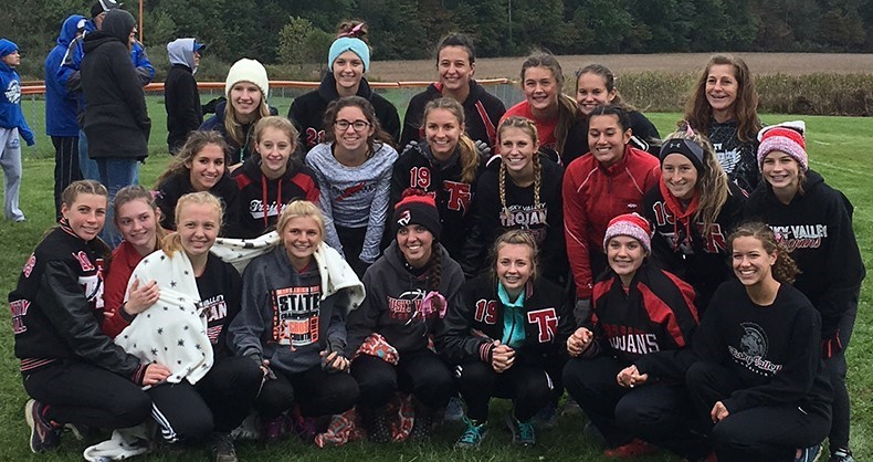 Girls' cross country poses after winning the IVC title