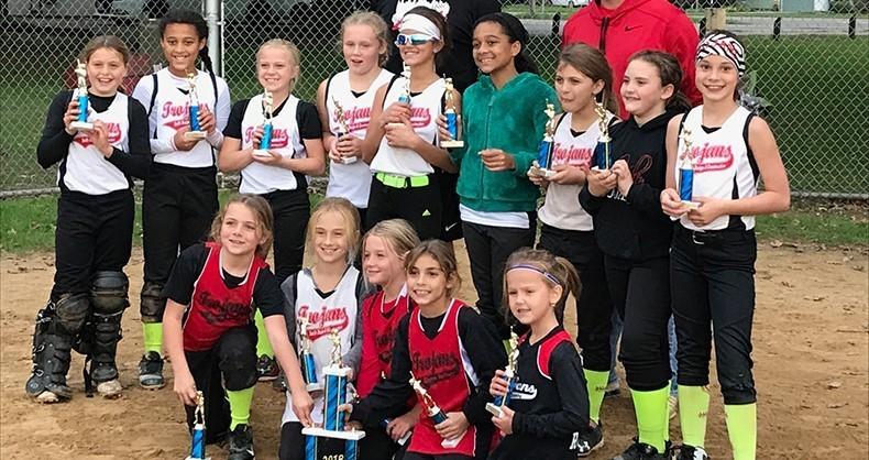 10U softball players pose with trophy
